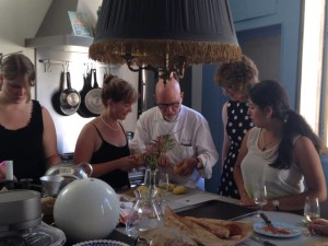Photo courtesy of Jody Littleton/Parkland College Grace Dyrek, Jody Littleton, Chef Alex, Rebecca Grosser, and Nadya Cortes take a French cooking class during Parkland's Study Abroad Program in France.